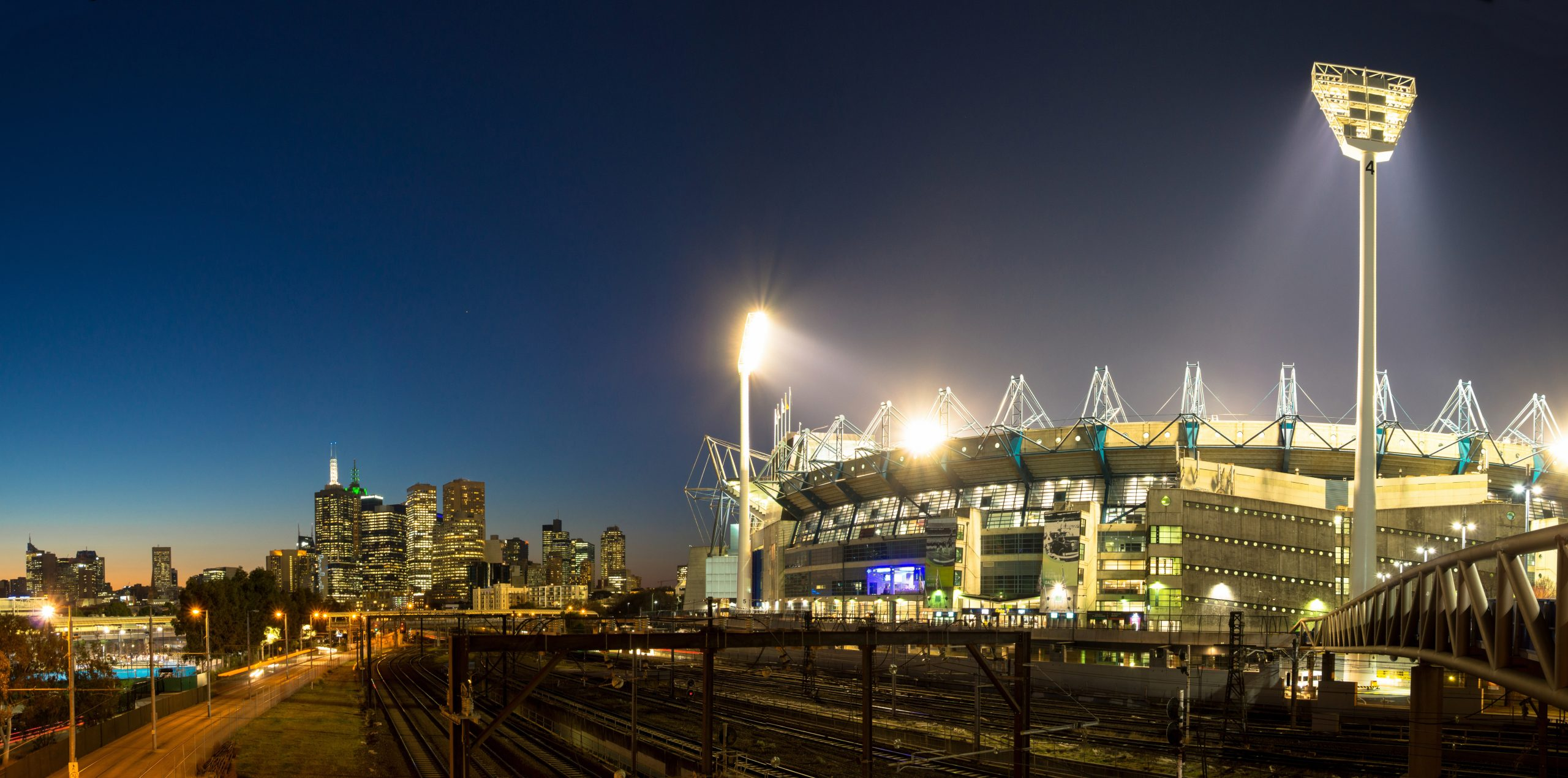 The Melbourne skyline  and the Melbourne Cricket Ground at sunset